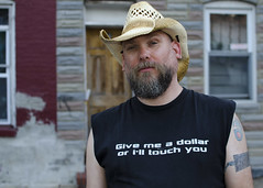Give me a dollar.. (Blinkofanaye) Tags: man black hat md funny humor tshirt baltimore givemeadollarorilltouchyou