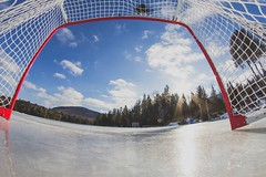 pound hockey / rink of dreams (WeGseB) Tags: rink lake dreams ice hockey net puck sun sky clouds woods tree chalet