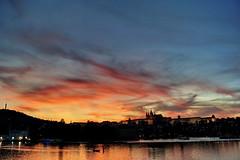 The sunset over the Vltava (Yuri Rapoport) Tags: 2012 hradčany praguecastle stvituscathedral church thevltavariver night prague czechrepublic malástrana