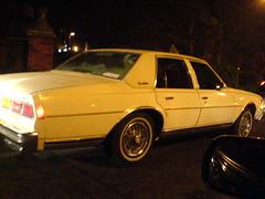 caprice side (merkleman) Tags: cameraphone old white classic chevrolet car night american pimp slab caprice swangas