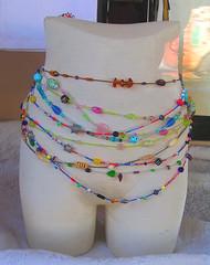 Strands of Colorful Beads (Vicki & Chuck Rogers) Tags: california color reflection photo beads rainbow erotic display body saratoga jewelry 200views torso storewindow manikin storedisplay strands novideo saratogavillage photosonly