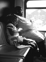 Happy Child (Elinesca) Tags: 2005 bw bus girl smile sadness child play father daughter fv5 parent parenting 71watertown bussride efolio dorchesterp