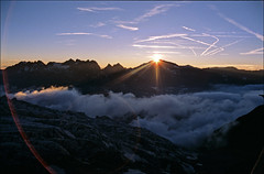 sunset on Aiguilles Rouges (Ron Layters) Tags: sunset france mountains alps nature geotagged slide valley transparency contrails chamonix rescanned argentiere hautesavoie vapourtrails pentaxmz10 chamonixvalley geo:lat=45973345 geo:lon=6956062 aiguillesrouges flickrfly ronlayters slidefilmthenscanned refugealbertpremier diamondclassphotographer flickrdiamond glacierdutourintheforeground