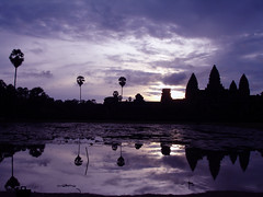 Sunrise over Angkor (mboogiedown) Tags: travel sunset reflection water silhouette architecture clouds sunrise asian temple asia cambodia southeastasia cambodian khmer purple culture buddhism angkorwat monsoon southeast tradition angkor wat hinduism unforgettable cultural worldheritage bayon wonderoftheworld sacredspace worldwonder kampuchea mapcambodia cambogia theravada travelforpeace experienceofalifetime monsoonsun houseofgod camboge beatravelernotatourist dontjustseetheworldexperienceit experiencecambodia buddhistnations