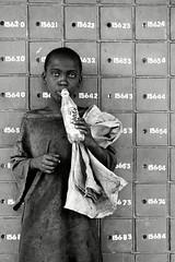 boy sniffing glue at post office, nakuru, kenya (Chris Lombardi) Tags: poverty africa boy kenya postoffice orphan numbers nakuru fanta solvent topv7777 homelessness streetportraiture solventabuse gluesniffing 6millionpeople