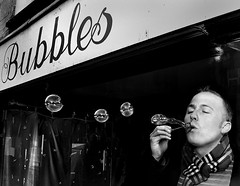 Bubbles (Aeioux) Tags: city uk deleteme5 light portrait people bw man tourism window topf25 freeassociation sign topv111 shop topv2222 taggedout 1025fav scarf paul interestingness fantastic birmingham topf50 topv555 topv333 topf75 air topv1111 been1of100 topc50 topc75 touch topv999 topv444 bubbles blowing blow saveme10 topc100 500v50f bubble topv777 topv3333 topf100 weeklysurvivor topi ybp interestingness8 topc125 aeioux popolo10 votedpopolobythepopolopeople aeiouxbirminghamuk