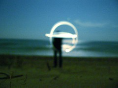 Terrestre (Ezu) Tags: subsonica terrestre lightdesign beach sillhouette moonlight sea water nightshot night signs 15fav thering uncertainreality sand topv111 1025fav