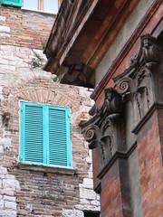 Detail: Window and Church (amelie a venezia) Tags: perugia italy italia finestra window arch arco serrande azzure blue shutter terracotta ionic ionico colonne columns capitali pedimento pediment mattone brick stucco pietra stone muro wall