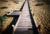 walk way (lomokev) Tags: wood lomo lca xpro lomography crossprocessed xprocess madera stones lomolca walkway dungeness agfa holz jessops100asaslidefilm agfaprecisa lomograph agfaprecisa100 cruzando precisa filelomo0905a29ps jessopsslidefilm ξυλο