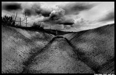 Stormdrain (Jeff T. Alu) Tags: black white phototoshop digital clouds rain storm cement surreal moody lonely dark outdoors bleak blackandwhite deserted illusion zen medetation medetate power impact graphic doom bright earthy dirt gritty intense visionary heat passion 4x4 remote california desolate dreamy nightmare euphoric