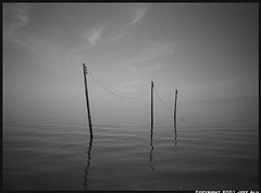 3 Poles (Jeff T. Alu) Tags: digital black white photoshop water salton sea sureal surreal moody lonely dark outdoors bleak blackandwhite deserted illusion zen medetation medetate power impact graphic doom bright earthy dirt gritty intense visionary heat passion 4x4 remote california desolate dreamy nightmare euphoric