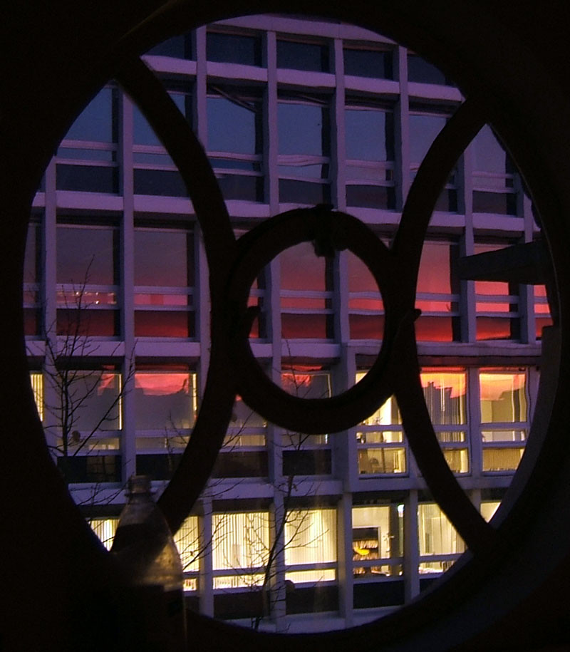 sunset reflection through round window