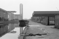 Surrey Canal - June 1970 (Elmar Eye) Tags: blackandwhite london industry canal timber surrey wharf deptford barge southwark towerblock surreycanal