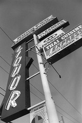 (ThenAndAgain) Tags: blackandwhite film negative scan photoshop aristaii iso400 foundationsinphotography pole sign wires thai liquor neon kungpao chinese lotto