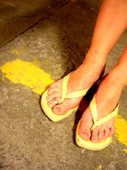 parking (Nika) Tags: shoes feet sandals parking garage toering yellow bestof2005