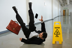 Businessman Falling (CleaningAsia.com) Tags: man building fall wet sign yellow businessman danger warning hall office risk floor symbol accident interior safety hallway lobby falling plastic suit caution slip briefcase wsh slippery hazard slipping precaution treacherous slipandfall wshc