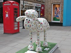 Looking at the phone box (Carol Spurway) Tags: london crosseyed sheep outdoor trail shaun sculptures cathkidston shaunthesheep shauninthecity paradisebunch