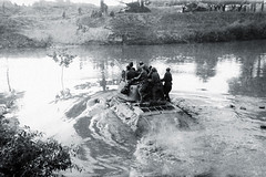 Red Army 44th Guards Tank Brigade T-34-85 crosses a river.