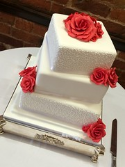 White piped & red rose wedding cake