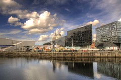 Tourist destination (Tony Shertila) Tags: 20150913153706 england gbr geo:lat=5340154969 geo:lon=299328089 geotagged liverpool unitedkingdom outdoor europe britain merseyside albertdock canningdock water weather day clouds cloudy sky buildings city cityscape architecture museum waterfront graces reflection boat ship dazzle liverbuilding liverbird glass canninghalftidedock