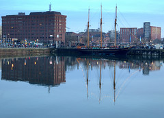 Blue reflections at Liverpool (Tony Worrall) Tags: liverpool merseyside mersey scouse northwest england northern uk update place location north visit area county attraction open stream tour country welovethenorth unitedkingdom scenic scene serene reflections wetreflection wet water calm cool cold dusk color colours beauty masts docks ship relic