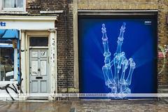 Brick Lane xray hand street art, London (Naomi Rahim (thanks for 4 million visits)) Tags: art london england uk unitedkingdom europe europa 2016 travel travelphotography eastlondon bricklane graffiti street streetphotography streetart wanderlust skeleton hand blue xray peace britain