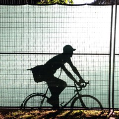 Ride By (Bhlubarber) Tags: shadow music canada bike bicycle silhouette mobile vancouver cycling levitation riding bici velo iphone