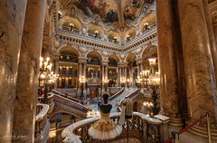 Dressed for the Opera (Abhi_arch2001) Tags: opera garnier french art craft sculpture france house lobby atrium stone marble warm paris parisian fashion architecture ornament ornate dress staircase stairs arches arcade golden frock tiara