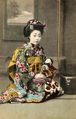 Yachiyo II with an Ichimatsu Ningyo 1910s (Blue Ruin 1) Tags: osakamaiko apprenticegeisha geiko geisha japanese japan meijiperiod taishoperiod 1910s handcolouredpostcard ichimatsuningyo japanesedoll yachiyoii koyachiyo osaka