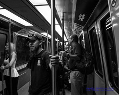 Folks On Ze North Train Loop in B&W (AvgeekJoe) Tags: iflyalaska bw blackwhite blackandwhite d5300 dslr ksea nikon nikond5300 seatac seatacairport seatacinternational seattletacomainternational seattletacomainternationalairport airport