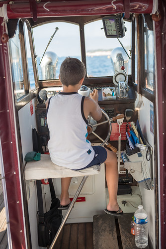 Boy steering a boat // Cassis @ France