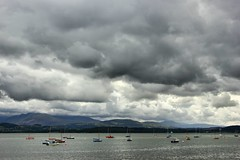 Beaumaris Harbour (Mrs Airwolfhound) Tags: ocean sea mountains wales canon boats scenery skies moody north beaumaris anglesey