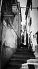 . ([ changó ]) Tags: wwwriccardoromanocom light luce shadow shade ombra chiaro scuro gradini stairs scale signora elder scendere elba isoladelba riomarina s5 samsung smartphone people person persona gente persone street shot streetshot