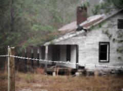 A Whiter Shade of Pale (TuthFaree) Tags: elements fence hff fencefriday barbwire house wood rural ga swga georgia tenanthouse abandoned white