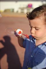 Kai fent bombolles (maikrofunky) Tags: boy summer 35mm canon kid bubbles nio burbujas bufa notreatment 600d