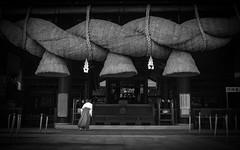 A female attendant in front of a shrine (Masahiko Kuroki (a.k.a miyabean)) Tags: bw architecture shrine noiretblanc 巫女 fujixe1 fujifilmsuperebcxf2841855mm
