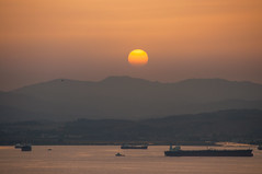 Sundown (Oliver J Davis Photography (ollygringo)) Tags: sun sunset sundown algeciras andalusia andalucia gibraltar bay water sea harbour port tanker ships shipping trade industry travel spain nikon d90 iberia iberian peninsula europe landscape palmones bahia losbarrios cadiz bird hill ridge sky warm mediterranean boats