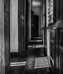 Sunlight on ancient wood (FotoGrazio) Tags: composition vigan fotograzio hallway windows digitalphotography structure worldphotographer shadows contrast waynegrazio museum photography mansion architecture wood pattern waynesgrazio doors landmark philippines texture filteredlight historical fineart design highcontrast ilocosnorte phototoart art architecturaldesign woodenwindows blackandwhite leadingline artofphotography