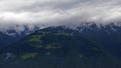 Hills of Sudtirol (kurecikamen) Tags: altoadige italia italien italy itálie hills hill cliffside cliff rock mountains mountain plain clouds sky high houses up autumn fall top naturns nature view naturno plaus bolzano trees wood far work
