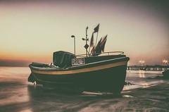 A boat in Orłowo - łódka na plazy w Orłowie (* mariozysk * (off for a while)) Tags: boat pier gdynia orłowo posla polska poland flags water sea coast beach dawn morning light before sunrise woda plaża brzeg morza morze świt przed wschodem słońca