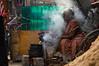 Woman (Raja V) Tags: food cook faceofindia beautiful india woman photowalk chennai thiruvanmiyur eat stove candit street