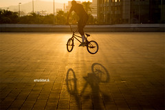 BMX. (arturii!) Tags: barcelona city light sunset shadow people urban man bike silhouette sport jump europe outdoor magic forum wheels ground catalonia bmw trick moment