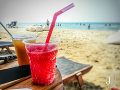 Water ice (Jim Makos) Tags: sea summer hot beach outdoors strawberry drink freezing greece gr refreshing thirsty waterice chalkidiki halkidiki makedoniathraki
