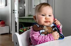 Hello? Isla on the Spoon (Jori Samonen) Tags: isla eat eating spoon bib food chair table baby girl sony ilce3000 e 19mm f28
