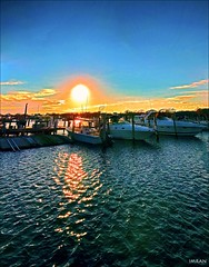 Magic Of Sunset Over Long Island Marina - IMRAN™ (Explored!) (ImranAnwar) Tags: 2016 beach boardwalk boating boats clouds dock dusk eastpatchogue flickr geography greatsouthbay history imran imrananwar inspiration iphone7 lake landscape landscapes life lifestyles longisland marina marine nature newyork outdoor outdoors patchogue peaceful philosophy photoshop red sea seaside seasons sky sun sunset tranquility travel water yachting