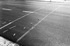 Before The Paint (bhop) Tags: california street leica blackandwhite bw white black film 35mm diy los angeles kodak iso400 f14 voigtlander trix rangefinder 400 crosswalk temporary m6 wandering premium nokton 400iso reflectors arista v700 leicam