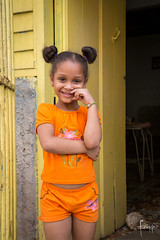 Havana, Cuba (Foraggio Photographic) Tags: life street travel portrait orange colour cute home girl beauty smile happy locals havana cuba streetphotography buns latin caribbean dailylife hairstyle centralamerica
