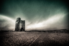 Facing the Storm (Mr Bultitude) Tags: ireland winter snow storm castle field stone clouds snowing burt donegal
