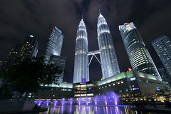 The Petronas Towers : Light Show (counteragent) Tags: show longexposure nightphotography light night canon reflections skyscrapers petronas wideangle malaysia twintowers kualalumpur fountains kl capitalcity thepetronastowers 60d worldcities counteragent