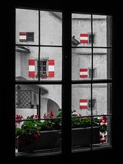 Hohenwerfen - Austrian Flags (Sebastian Bayer) Tags: castle austria sterreich urlaub hohenwerfen burg colorkey salzburgerland rwghohenwerfen